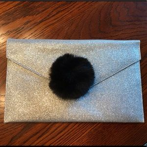 ASOS silver sparkly clutch with black Pom Pom!